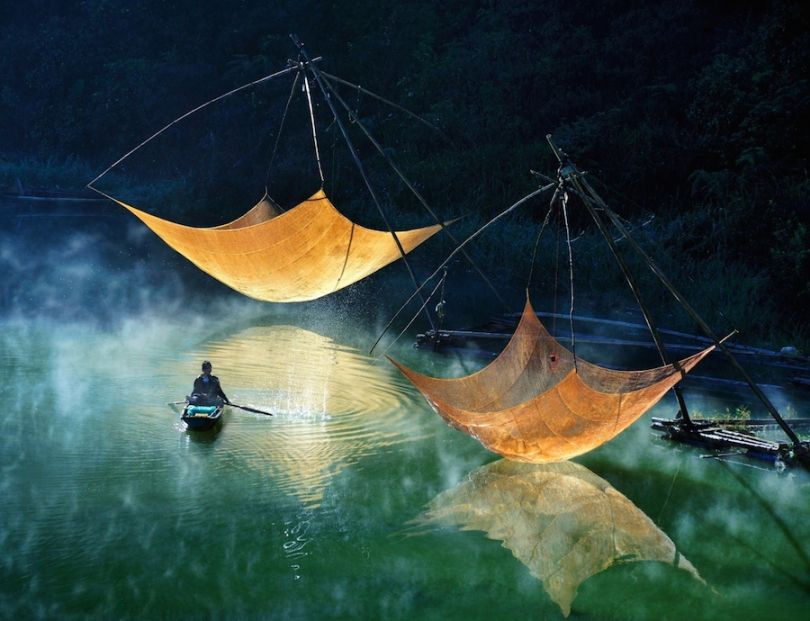 Checking fishing net in Vietnam. Photograph: Hoang Long Ly /Courtesy of Atkins CIWEM Environmental Photographer of the Year